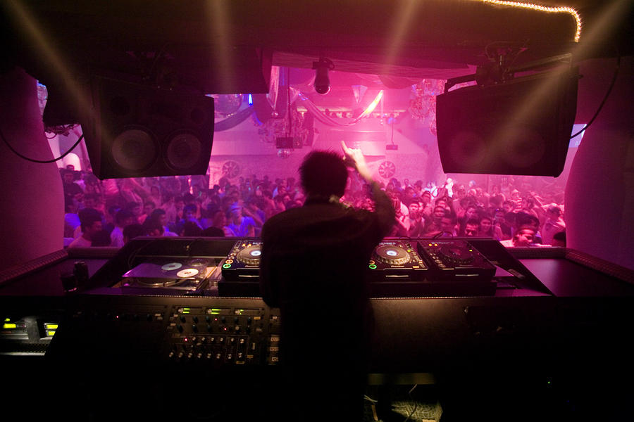 A Dj Plays To His Crowds On A Busy Photograph