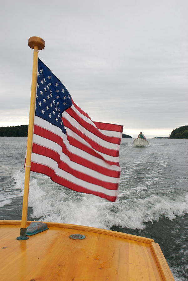A Flag Waves On The Stern Of A Maine Photograph  - A Flag Waves On The Stern Of A Maine Fine Art Print