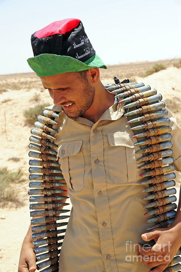 A Free Libyan Army Soldier With An Photograph