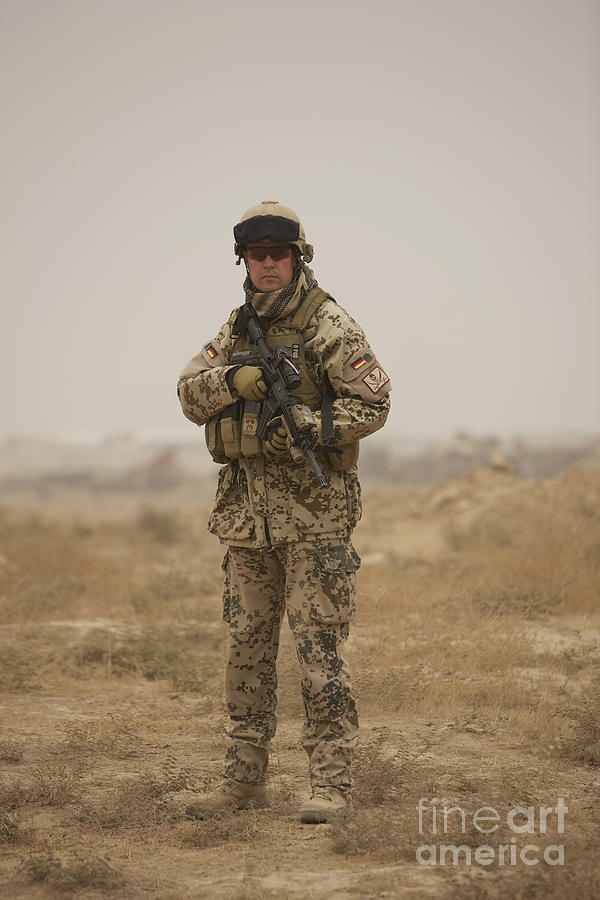 Operation Enduring Freedom Photograph - A German Army Soldier Armed With A M4 by Terry Moore