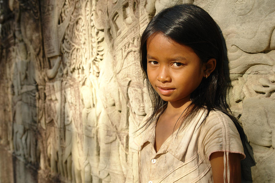 In Cambodia. Photograph - A Girl At Bayon In Cambodia. Fine Art Print