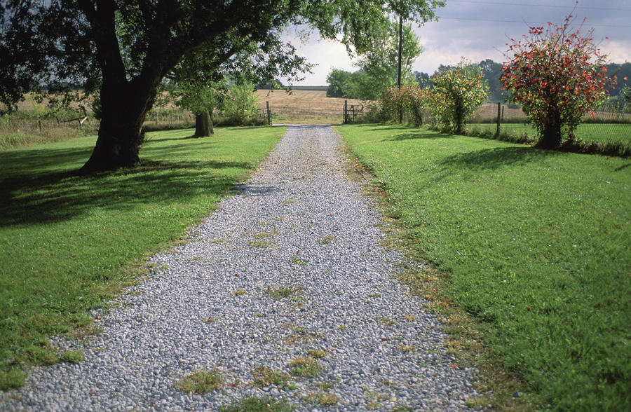A Gravel Road Marks The Entranceexit Photograph