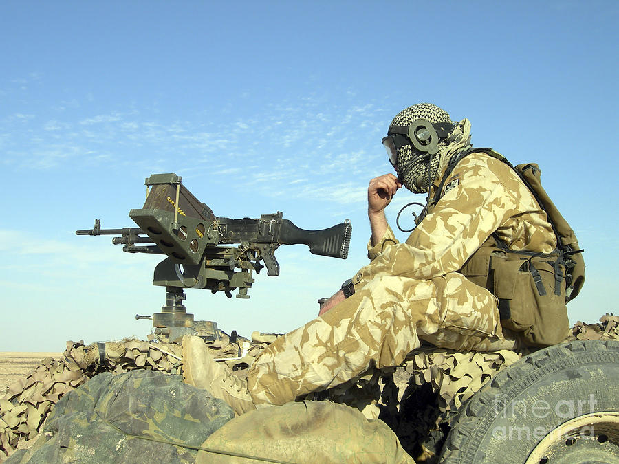 A Gunner Sits Atop A British Army Wmik Photograph