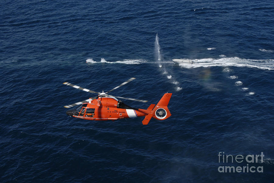A Helicopter Crew Trains Off The Coast Photograph