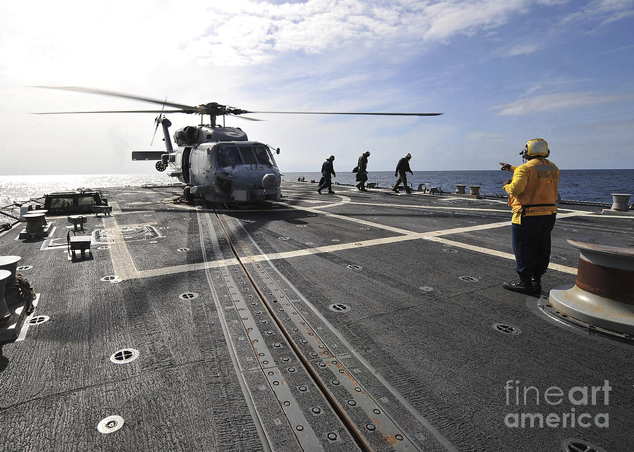 Navy Photograph - A Helicpter Sits On The Flight Deck by Stocktrek Images
