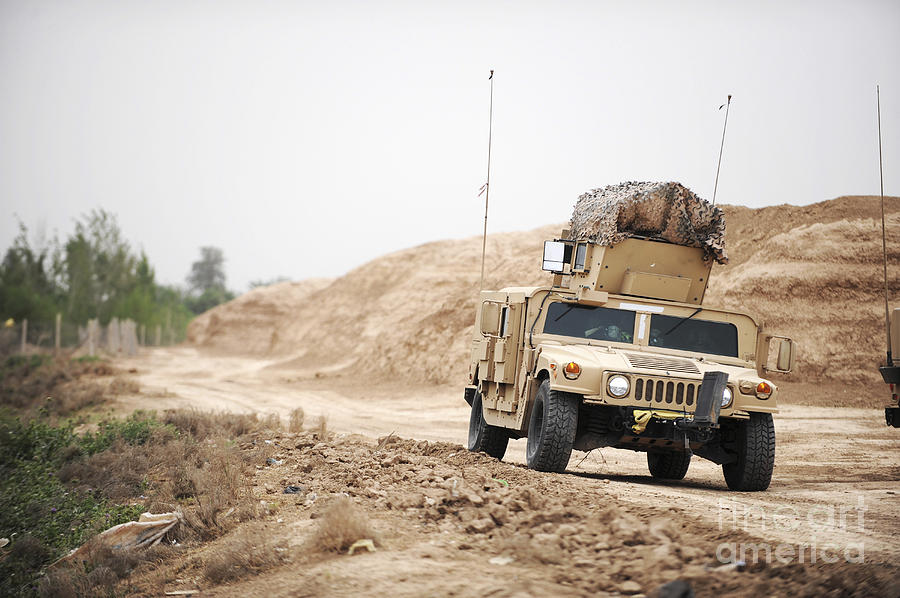 A Humvee Conducts Security Photograph  - A Humvee Conducts Security Fine Art Print
