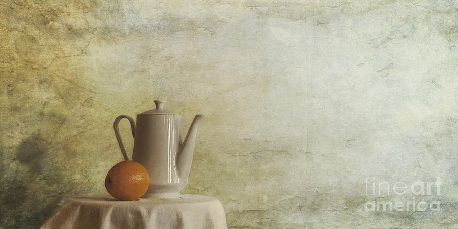 A Jugful Tea And A Orange Photograph