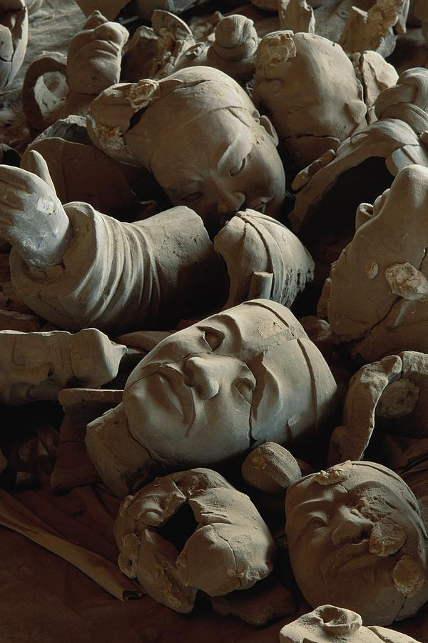 A Jumbled Heap Of Terra-cotta Heads Photograph