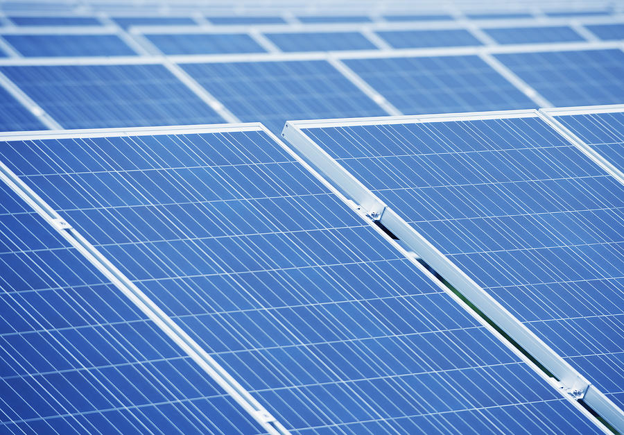 A Large Group Of Solar Panels Tilted Photograph by Dave ...