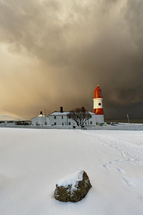 A Lighthouse And Building In Winter Photograph  - A Lighthouse And Building In Winter Fine Art Print
