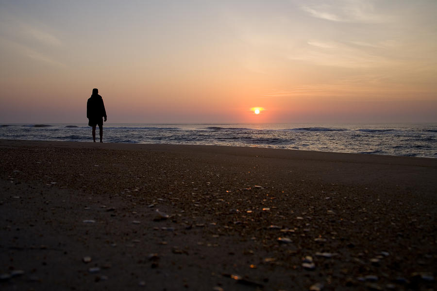 A Lone Figure Enjoys The Ocean Sunrise Photograph
