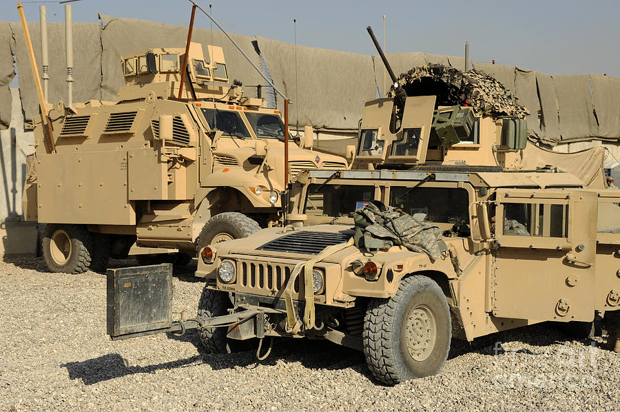 A M1114 Humvee Sits Parked In Front Photograph By