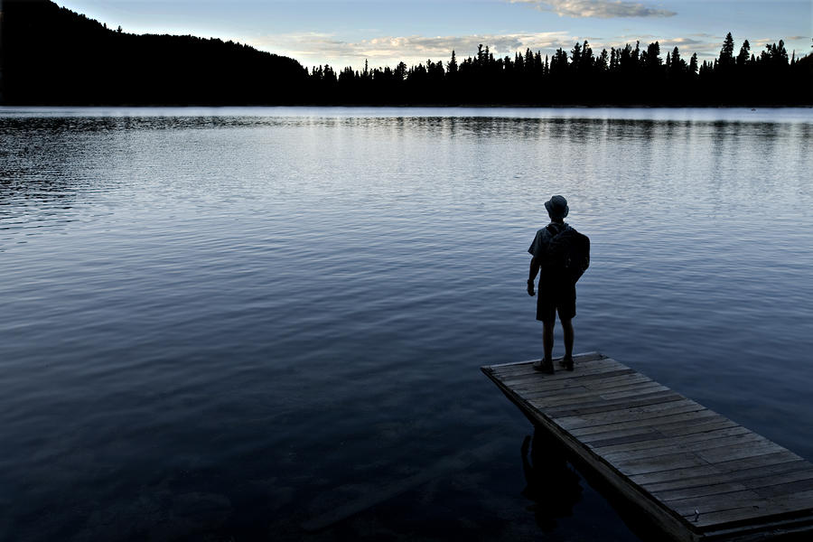 A Man Looking Across A Lake. Into Photograph  - A Man Looking Across A Lake. Into Fine Art Print