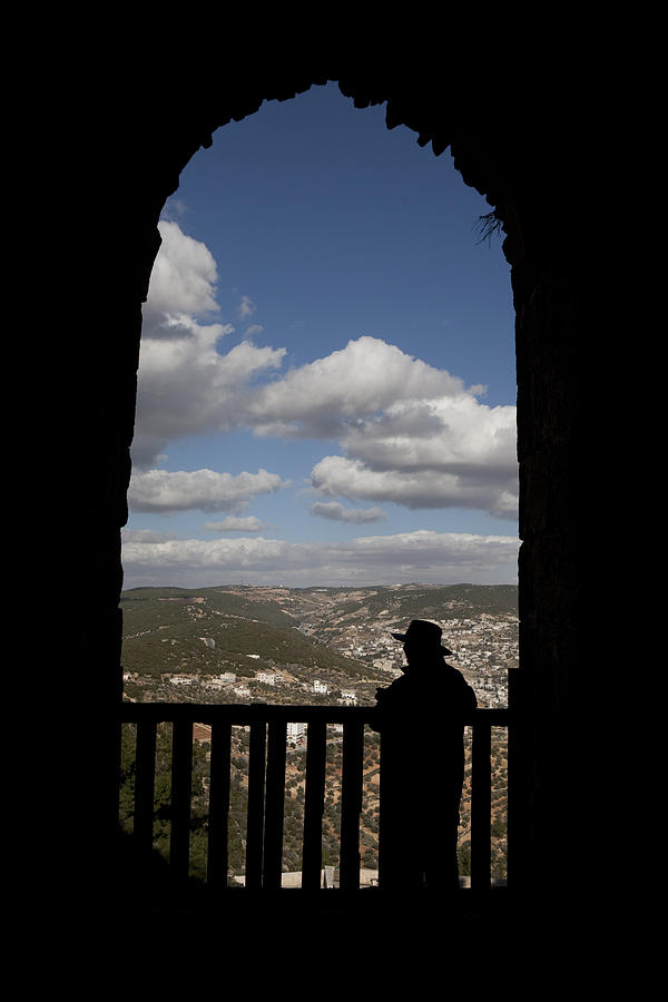 A Man Looks Out Of Ajloun Castle Photograph