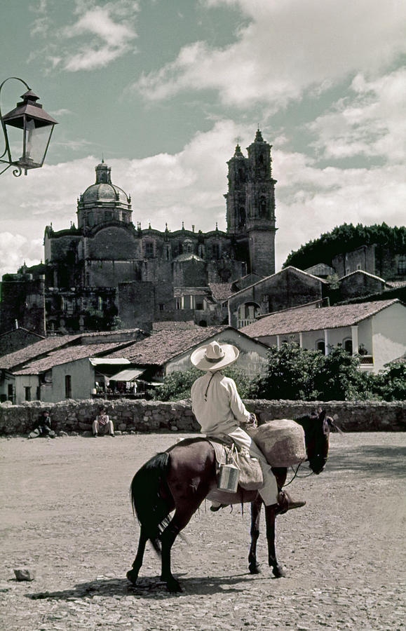 A Man On Horseback Looks At The Borda Photograph