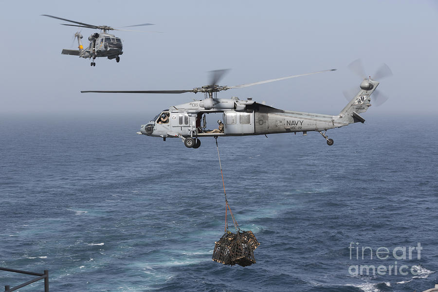 A Mh-60s Knighthawk Transfers Cargo Photograph