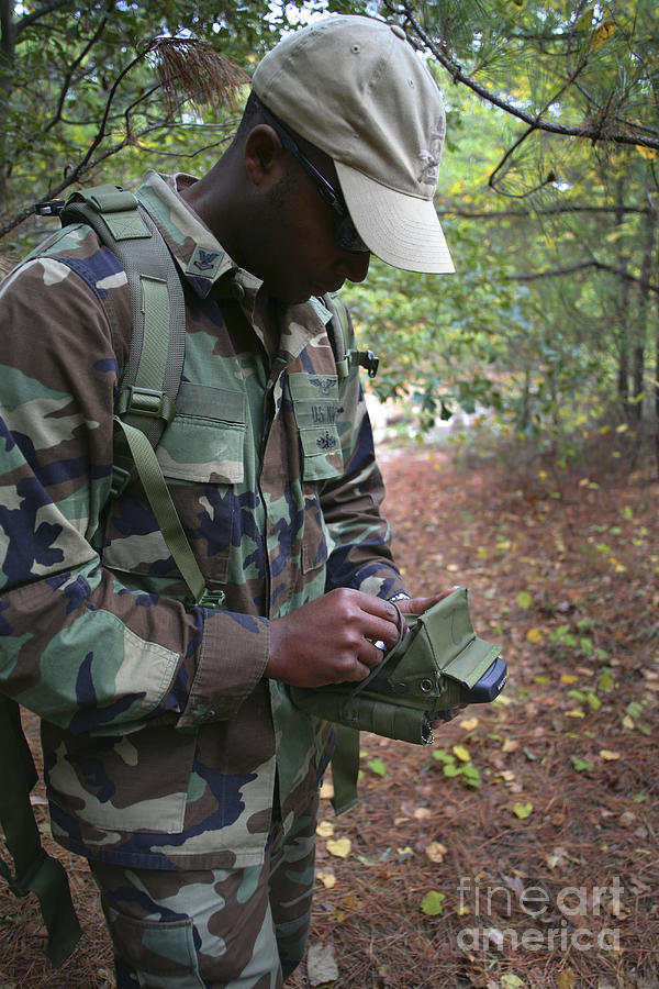 A Military Technician Uses A Pda Photograph