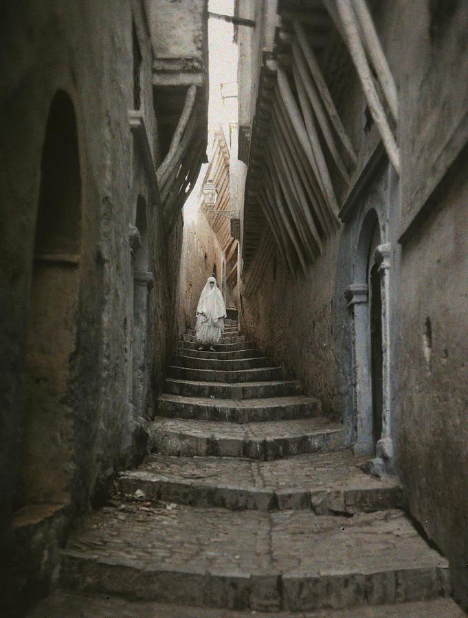 A Muslim Woman Walking Down A Steep Photograph