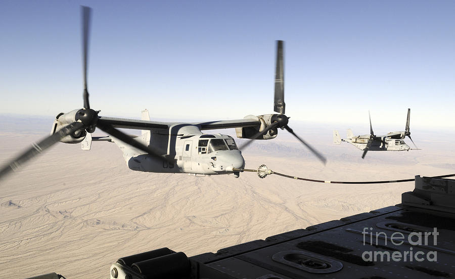 A Mv-22 Osprey Refuels Midflight While Photograph