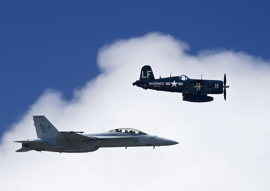A Navy F-18 And A Wwii Vintage F4u Photograph