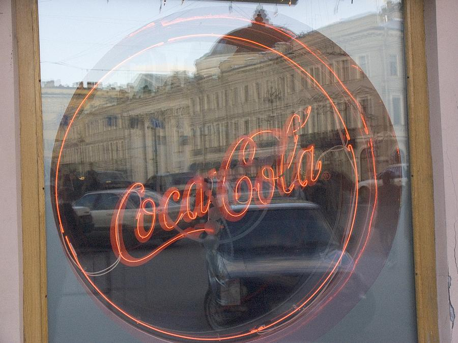 A Neon Coca Cola Sign Is Displayed Photograph