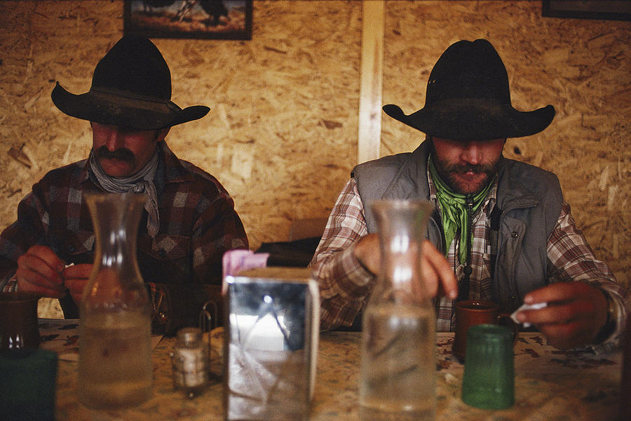 A Pair Of Cowboys Enjoy A Cup Of Coffee Photograph