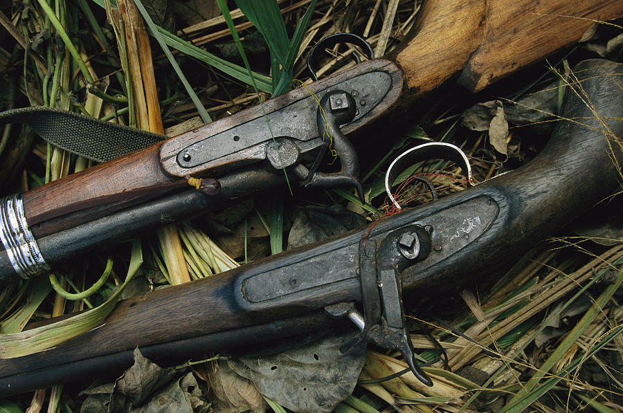 A Pair Of Old Flint-type Rifles Lying Photograph