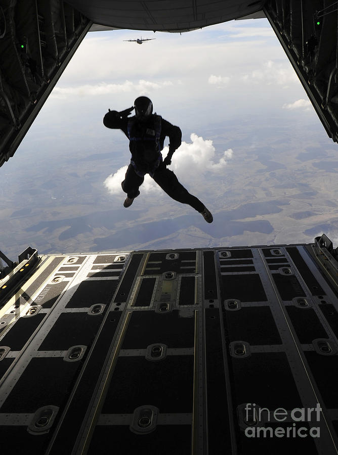 A Paratrooper Salutes As He Jumps Photograph