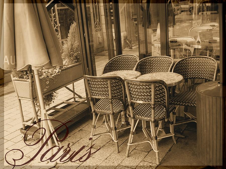 A Parisian Sidewalk Cafe In Sepia Photograph