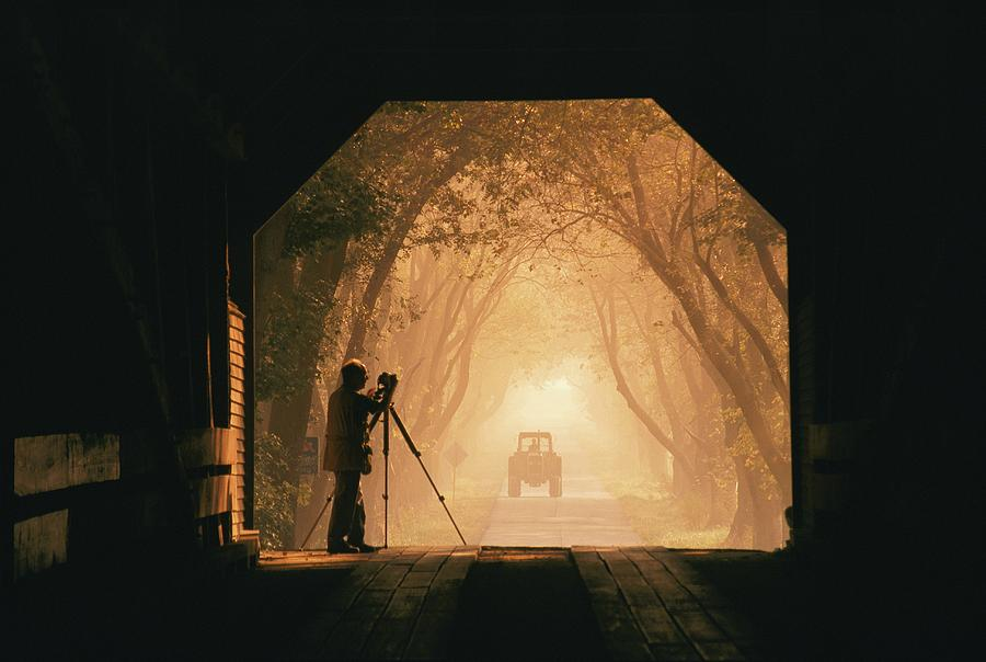 A Photographer Sets Up His Camera Photograph