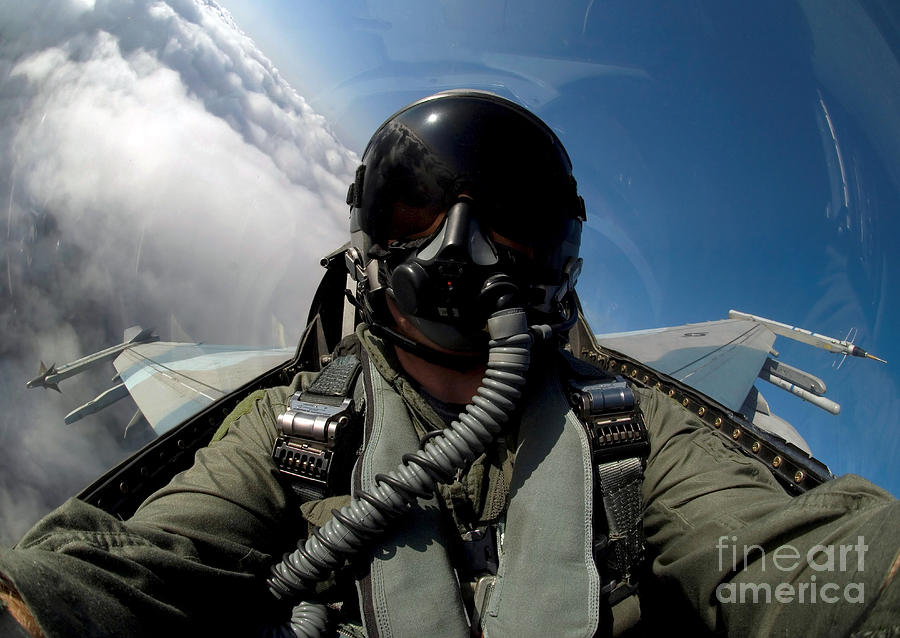 A Pilot In The Cockpit Of An F-16 Photograph