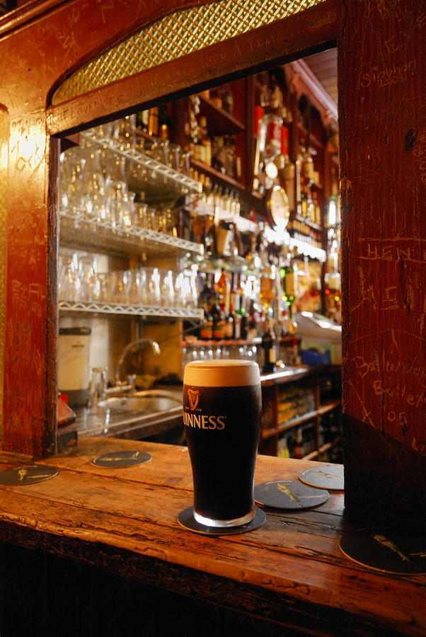 A Pint Of Dark Beer Sits In A Pub Photograph