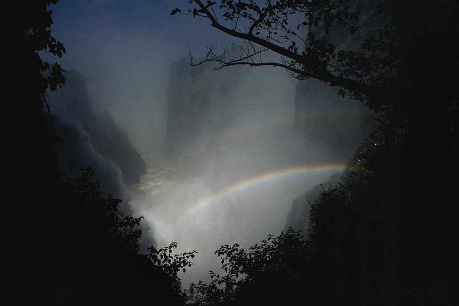 Natural Forces And Phenomena Photograph - A Rainbow Arcs Across Victoria Falls by James L. Stanfield