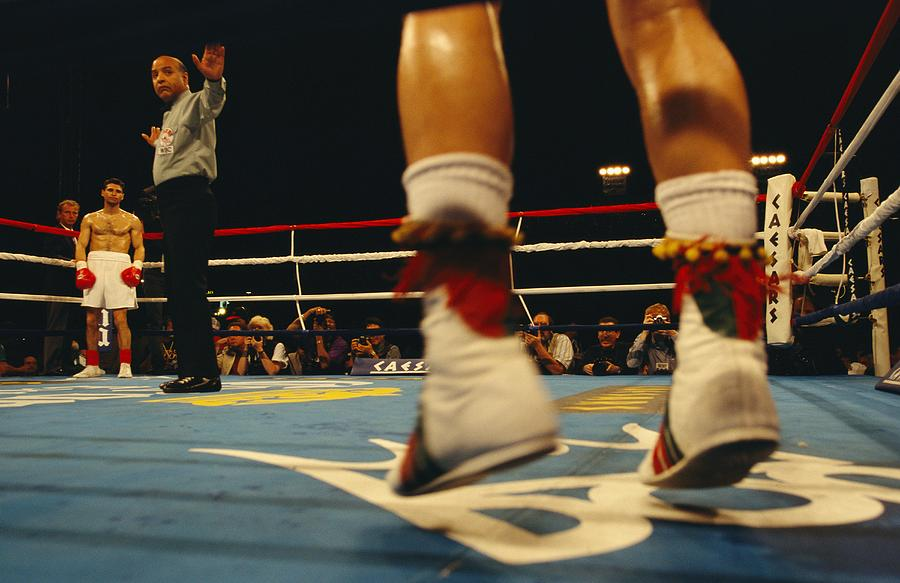 A Referee And Boxers Prepare Photograph