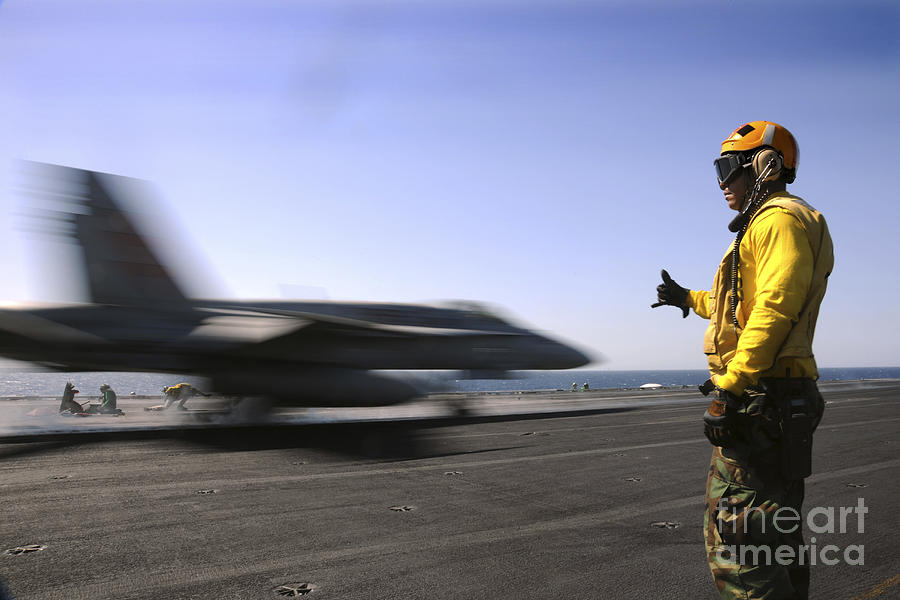A Sailor Ensures An Fa-18c Hornet Photograph