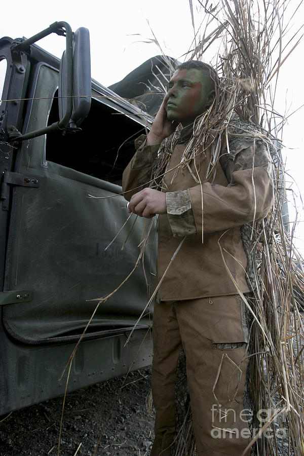 A Scout Observer Applies Camouflage Photograph