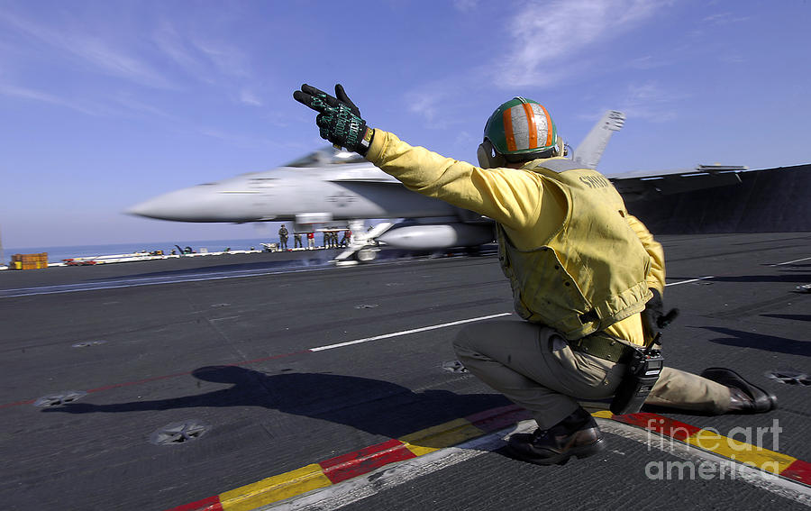 A Shooter Signals The Launch Of An Photograph