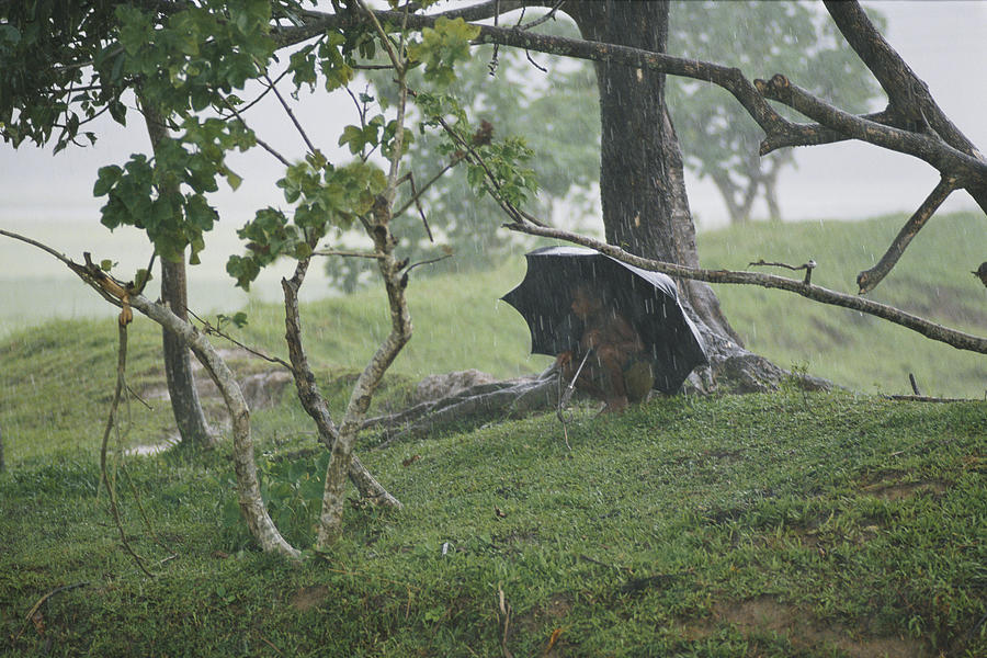 Monsoons Photograph - A Small Child Takes Refuge by James P. Blair