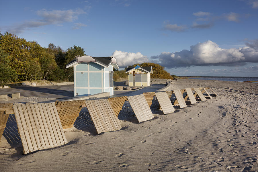 A Small Wooden Wall On Parnu Beach Photograph