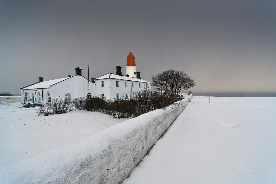 A Snow Covered Fence With A Lighthouse Photograph  - A Snow Covered Fence With A Lighthouse Fine Art Print