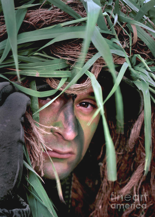 A Soldier Camouflaged In His Ghillie Photograph