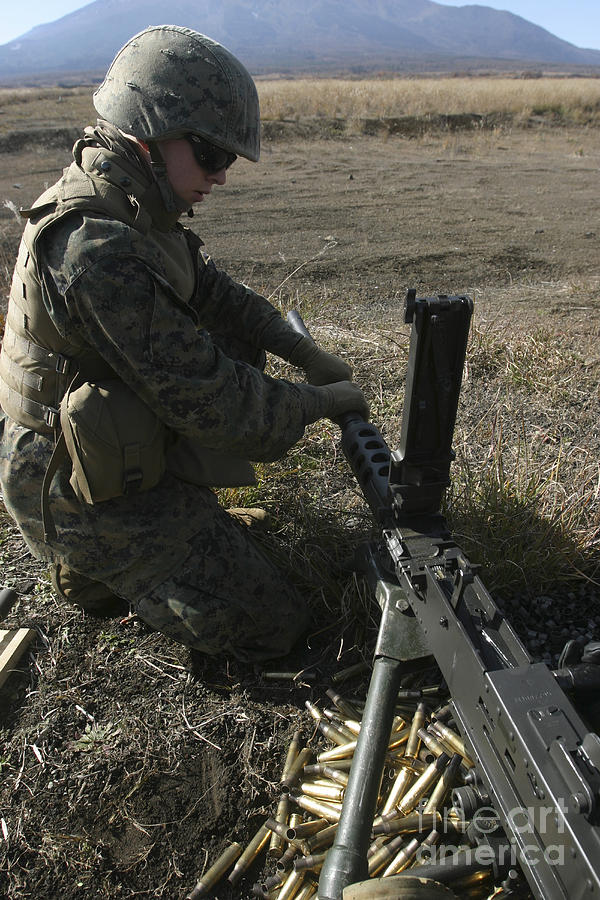 A Soldier Changes The Barrel Of An M2 Photograph  - A Soldier Changes The Barrel Of An M2 Fine Art Print