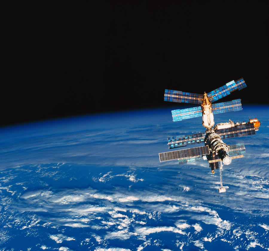 Horizontal Photograph - A Space Station Orbiting Above Earth by Stockbyte