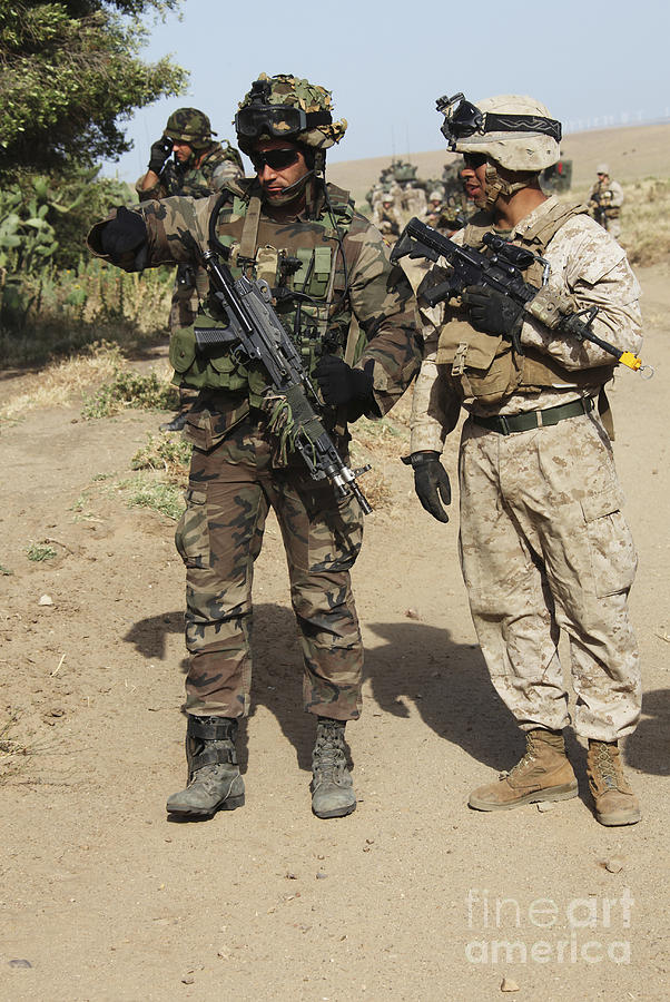 Spain Photograph - A Spanish Marine Points Out An by Stocktrek Images