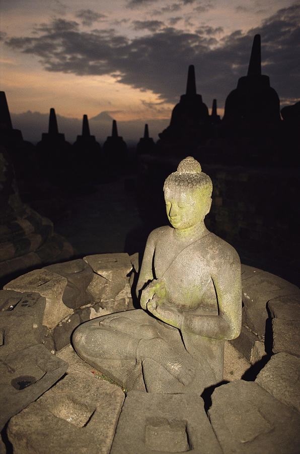 A Statue Of Buddha,  Borobudur, Java Photograph