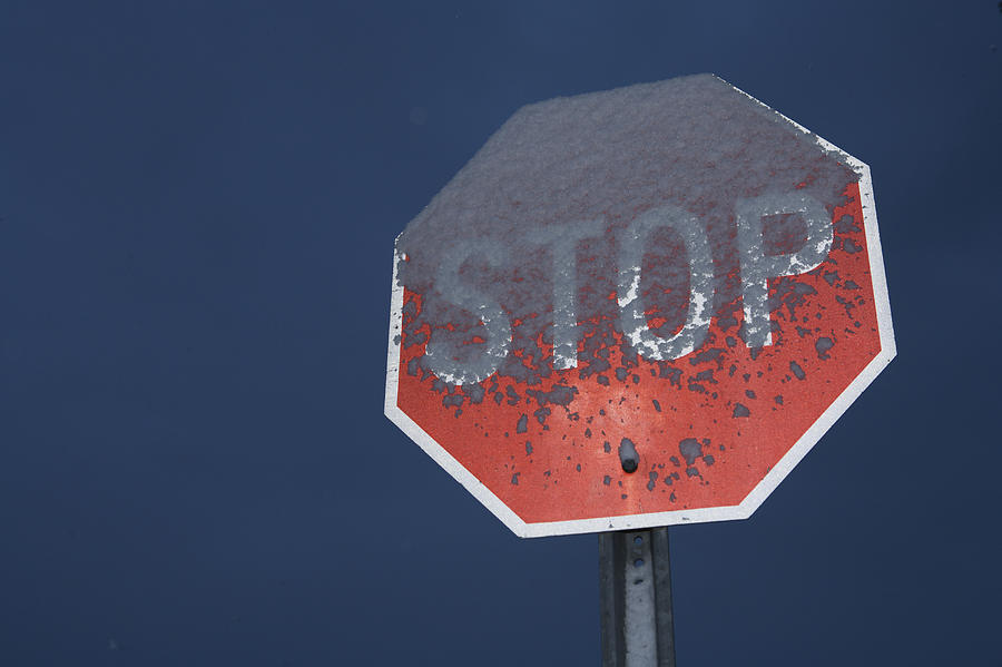 A Stop Sign Covered In Snow Photograph