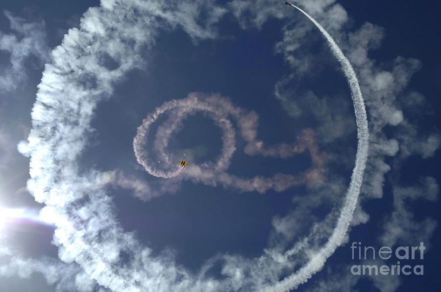 A Stunt Plane Flies Photograph