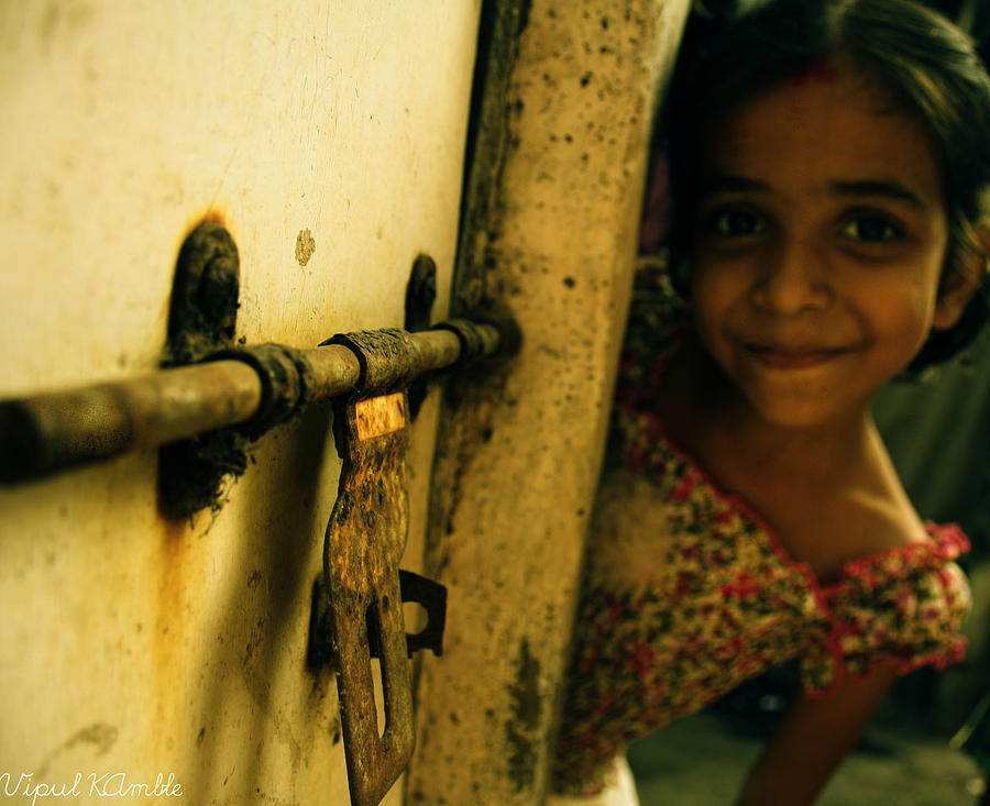 Cute Photograph - A Sweet Smile Beyond Door by Vipul Kamble