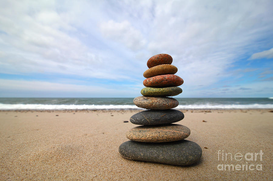 A Tower Of Stones On The Beach Photograph