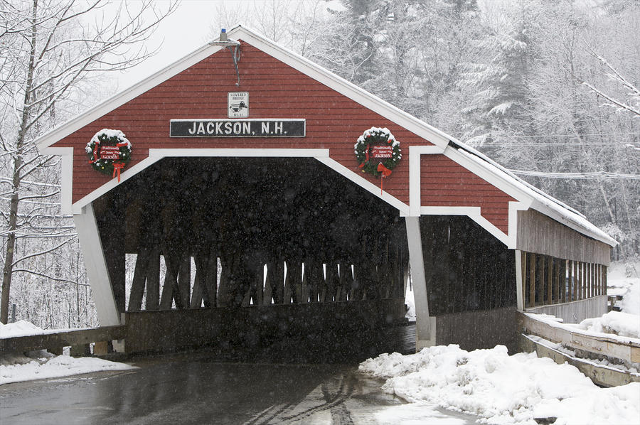 A Traditional Covered Bridge On A Snowy Photograph